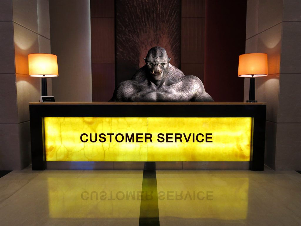 Scary Service monster behind customer service desk